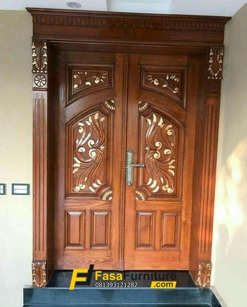 Desain Pintu Kupu Tarung Ukiran Mewah